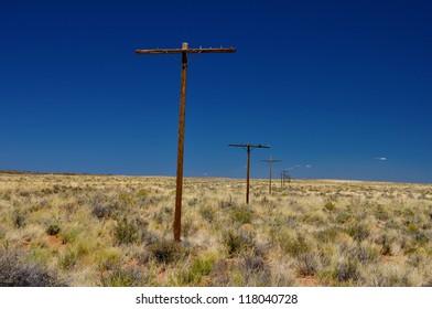 Wooden Telegraph Poles in the Empty Desert