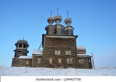 Wooden temple complex. Church of St. Nicholas, 1636 year built and bell tower of the 17th-19th centuries in the twilight. Vorzogory village, Arkhangelsk region, Russia