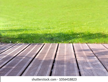 Wooden terrace exotic to greenery lawn of a garden