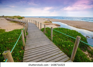 Wooden terrace on the sandy seashore on a sunny day. Porto, Portugal, Europe