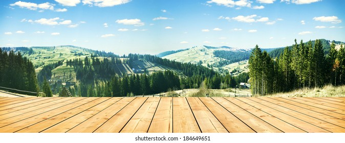 wooden terrace and panorama of early spring in the mountains. Carpathian, Ukraine, Europe