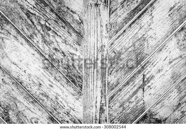 Wooden texture of grey color with scratches and cracks, which can be used as a background