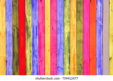 Wooden texture in multi-colored striped. Colorful background with rainbow stripes.