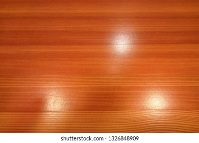 Wooden texture with spots of celling lights