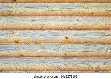 Wooden texture of the wall of logs