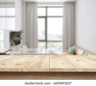 Wooden textured desk with blur interior. Concept table and fon