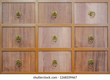 Wooden textured drawers wall background in chinese herbal medicine shop in chinese drug store, Crop of Brown Chinese Lacquered Apothecary Cabinet with open drawer.
