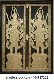 Wooden thai style and golden painting doors in northern temple of Thailand.