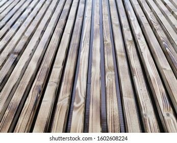 Wooden thin slats with traces of firing. Thin vertical slats.Wooden background. Abstract background.