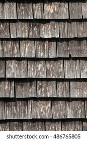 Wooden tiled old american house roof closeup as background