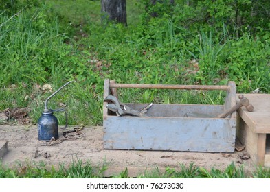 wooden tool box and oil can
