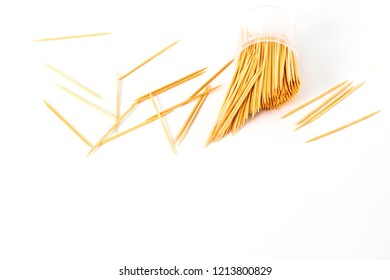 Wooden toothpick in cup isolated background.
