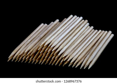 Wooden toothpicks isolated against a black background