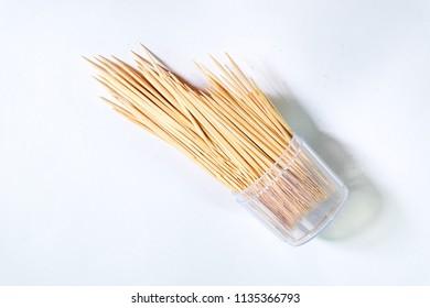 Wooden toothpicks on white background. Toothpick splatter.