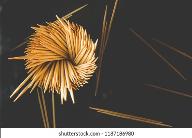 A lot of wooden toothpicks. Toothpick on a black background.