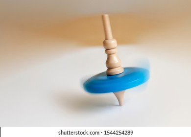 wooden Top toy spinning on a table