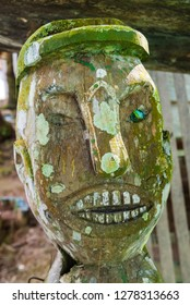 Wooden totem at entrance of village, Mengkak Iban Longhouse, Batang Ai National Park, Sarawak, Malaysian Borneo, Malaysia.