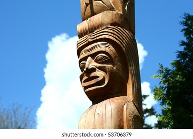 A wooden totem pole in Vancouver BC