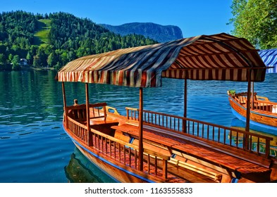 Wooden tourist boat on Lake Bled, Slovenia. Lake Bled is located in the Julian Alps in northwestern Slovenia, where it adjoins the town of Bled. It is a major tourist sight of the country.