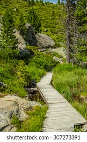 Wooden tourist path in lake Windebensee in Carinthia, Nockalmstrasse, Austria