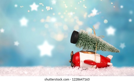 wooden toy aircraft with green christmas tree on top in winter