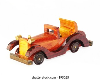A wooden toy automobile.