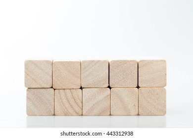 Wooden toy blocks on white background.