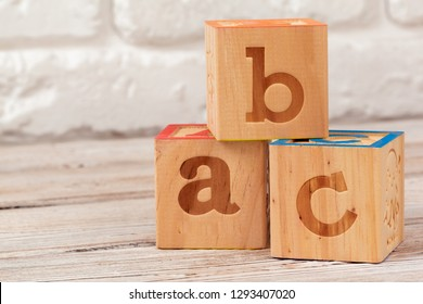 Wooden toy Blocks with the text: abc