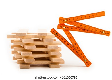 Wooden toy blocks with tools isolated on white background.