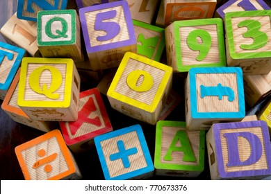 Wooden toy building letter blocks.