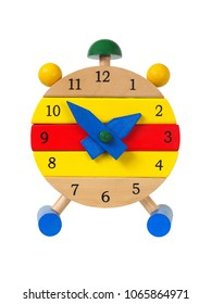 Wooden toy clock isolated on white background
