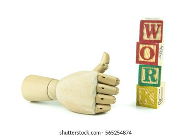 wooden toy cubes are used to create the word work.