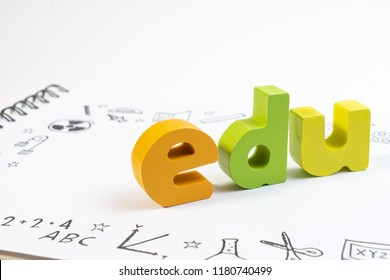 Wooden toy EDU on notebook with drawing doodle for education. Education and school background for STEM learning knowledge on white background.