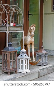Wooden toy horse and candle holders near flower shop