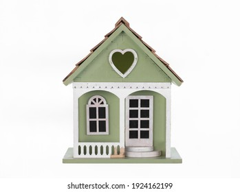 wooden toy house cottage isolated on white background