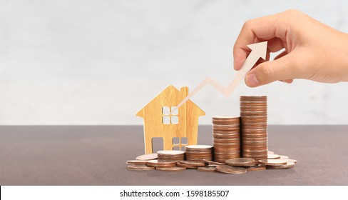 Wooden toy house Mortgage property home concept Buying for family, coins in hand Business Ideas