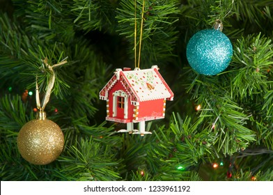 Wooden toy house  on the Christmas tree