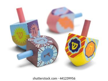 Wooden Toy Jewish Dreidels Isolated on White Background.