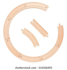 Wooden toy railroad track. Conceptual image of connection, pieces and travel