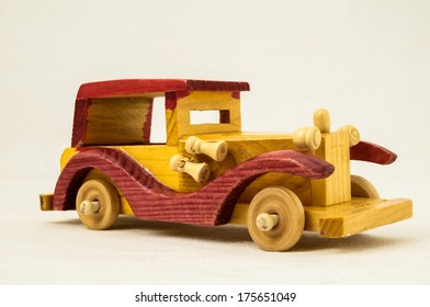 Wooden Toy Red and Yellow Car on a white Backgraund