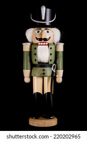 wooden toy soldier nutcracker isolated on black background