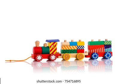 Wooden toy train with colorful blocks isolated over white background. Montessori educational toys.