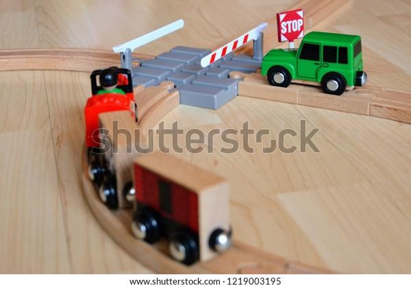 Wooden Toy Train Rail Crossing Scene Stock Photo (Edit Now