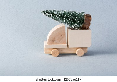 Wooden toy truck with christmas tree on is top