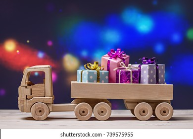 Wooden toy truck on festive background with space for text as Christmas greeting card.