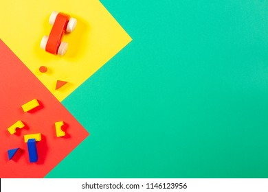 Wooden toys on colorful background, top view