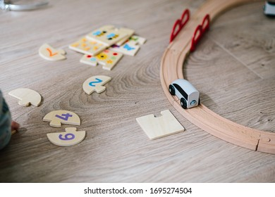 Wooden toys with railway train and numbers on a playground indoor wooden floor