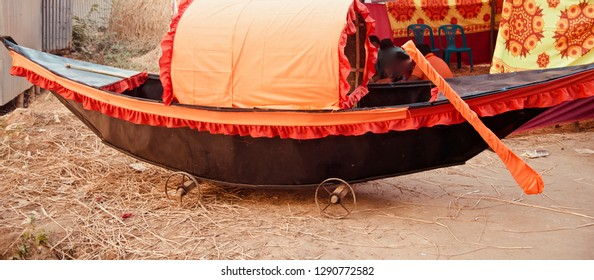 A wooden traditional boat kept around a soil surface isolated photo