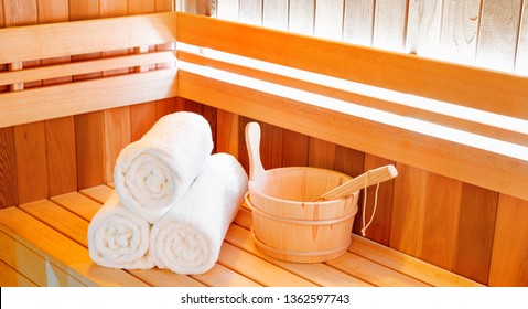 a0d7b27ca0 Wooden traditional sauna for relaxation with bucket of water and set of  clean towels