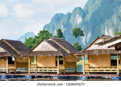 Wooden traditional Thai bungalows on water with mountian background at Ratchaprapha Dam, Khao Sok National Park, Surat Thani, Thailand.